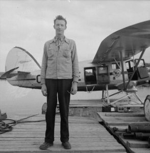Photo: Bibilothèque et Archives nationales du Québec # 03Q-E6S7SS1P78816. Bob Birkett at the Figuery Lake base with Norseman CF-BSE.