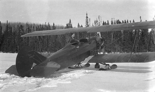 CF-ABI, a Travel Air 4000, leased by CAFC in 1929-30. Shown here at Brett Lake, Ontario in 1931 while operated by Skyways. Photo: Library and Archives Canada #PA 102041.
